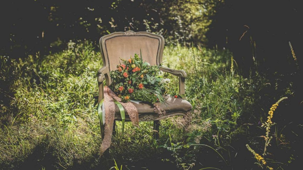 eco friendly wedding bouquet on a chair in forest